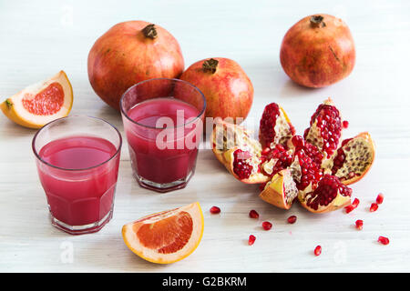 The pomegranate liqueur in a glasses on a wooden table. Selective focus. - Stock Photo