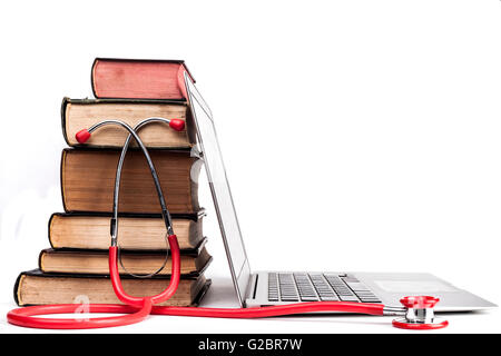 Old Books Pile With Silver Laptop and Stethoscope Isolated on White Background - Stock Photo