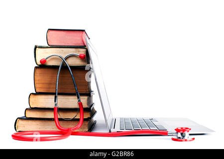 Red Stethoscope and Old Books  With Silver Laptop Isolated on White Bakcground - Stock Photo