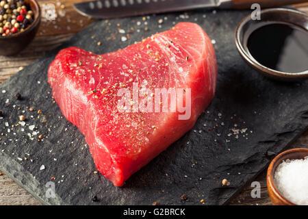 Raw Organic Pink Tuna Steak with Salt and Pepper - Stock Photo