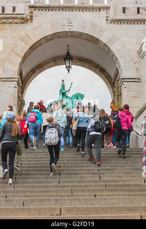 A group of students arrive at the Fishermens Bastion on the Var Hill, on the Buda side of the city of Budapest, - Stock Photo