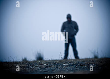 Blurred Hooded Figure in Fog - Stock Photo