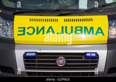 Mirror writing on the front of ambulances, where the word 'AMBULANCE' is written in very large mirrored text, so - Stock Photo