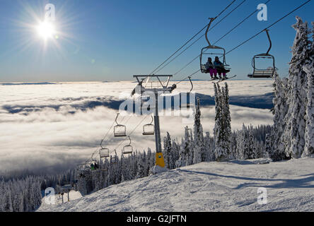Chairlift at sunrise near the top of Sun Peaks Resort, Thompson Okangan region, British Columbia, Canada - Stock Photo