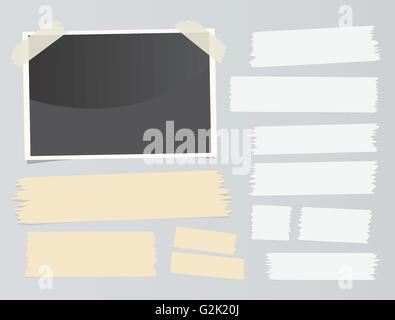 Set of different size sticky, adhesive tape, banners pieces and instant film are stuck on gray background - Stock Photo
