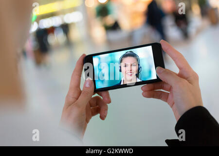 skype video call with a smartphone - Stock Photo