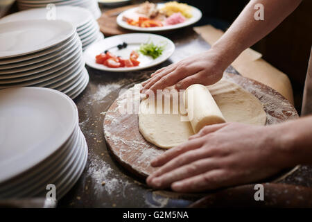 Rolling dough - Stock Photo