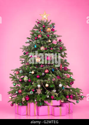 Decorated Christmas tree with presents and gift boxes - Stock Photo