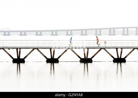 Joggers on bridge in Parque das Nacoes, Lisbon - Stock Photo