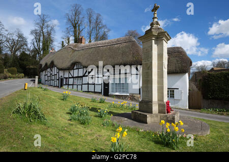 War memorial and thatched cottages, Wherwell, Hampshire, England, United Kingdom, Europe - Stock Photo