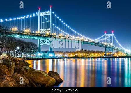 Robert F. Kennedy Bridge (aka Triboro Bridge) by night viewed from Randalls Island, New York - Stock Photo