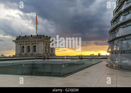 Stormy skies above The Reichstag Building ,which houses The German Bundestag or German Parliament with large glass - Stock Photo