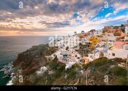 Oia or Ia at sunset, Santorini, Greece - Stock Photo