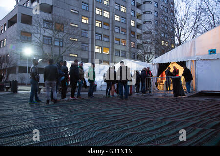Berlin, Germany, refugees wait in the evening before LaGeSo - Stock Photo