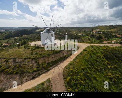Aerial view of old deserted windmill with Silves town in background, Algarve, Portugal - Stock Photo