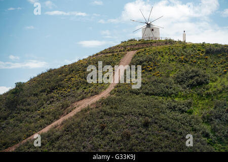 Old deserted windmill near Silves town, Algarve, Portugal - Stock Photo