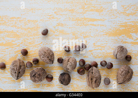 Walnuts and hazelnuts on a wooden background - Stock Photo