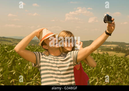 Young couple taking selfie, vintage style - Stock Photo
