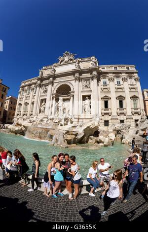 Crowds of tourists at the Trevi Fountain, Rome, Italy - Stock Photo