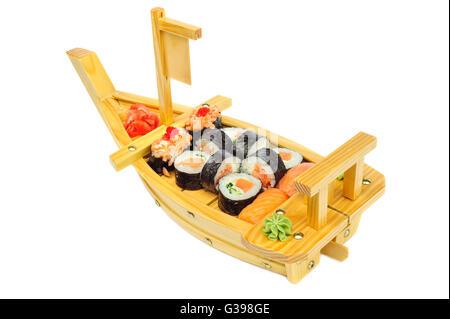 Sushi set of rolls on ship shaped plate - Stock Photo
