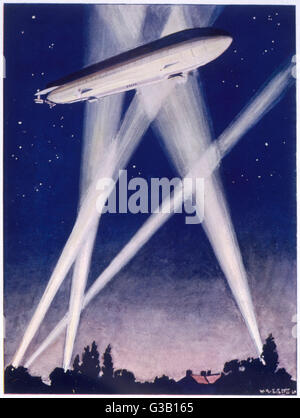 A Zeppelin raider is caught in  the searchlights over the  countryside        Date: 1915-16 - Stock Photo