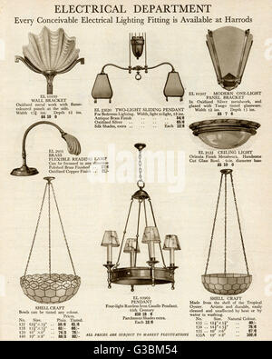 A variety of ceiling and wall light fittings, using oyster shell and oxidized silver, available from the electrical - Stock Photo
