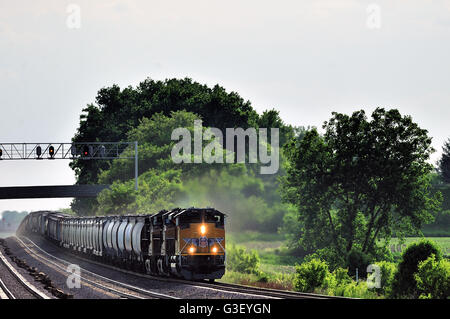 LaFox, Illinois, USA. An eastbound Union Pacific freight train headed by three locomotive units with a mixed consist - Stock Photo