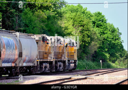 An eastbound Union Pacific freight train headed by three locomotive units with a mixed consist in tow. - Stock Photo