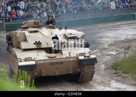 Bovington, Dorset, UK. 25th June 2016. Tankfest military show. Challenger 1 tank in main arena with crowd Credit: - Stock Photo