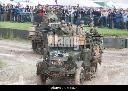 Bovington, Dorset, UK. 25th June 2016. Tankfest military show. M5A1 American Half Track vehicles in main arena Credit: - Stock Photo
