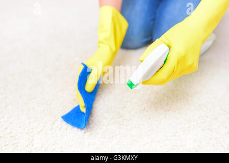 Carpet Cleaning spray. Close-up. Focus on the hand with a spray. - Stock Photo