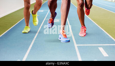 Composite image of close up of sportsman legs running - Stock Photo