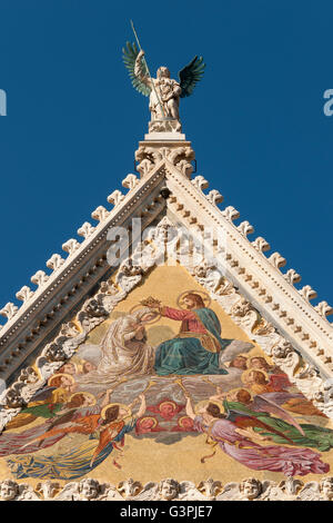 Gable of facade of Cathedral of Siena, Duomo di Siena with Mosaic representing Coronation of Virgin by Luigi Mussini, - Stock Photo
