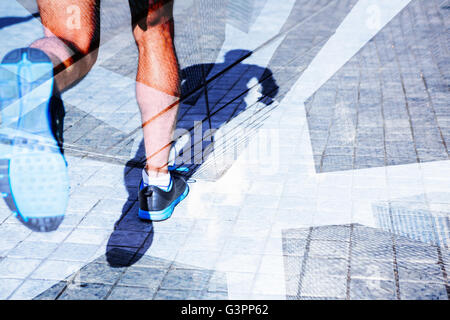 Composite image of close up view of athletes legs running - Stock Photo
