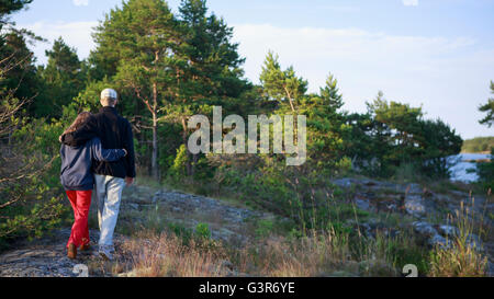 Sweden, Sodermanland, Stockholm Archipelago, Rear view of teenage girl (16-17) and young man walking - Stock Photo