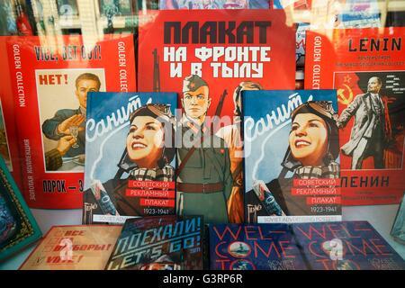 Saint Petersburg Russia. Modern books present patriotic Soviet era graphic art in bookstore window display on Nevsky - Stock Photo