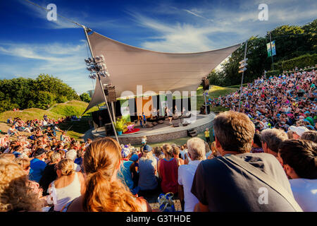 Sweden, Skane, Malmo, Crowd watching performance taking place on outdoor stage - Stock Photo