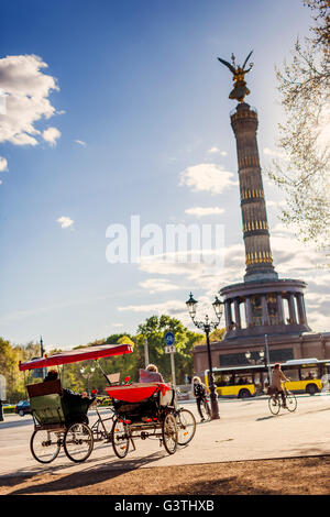 Germany, Berlin, Tiergarten, Victory Column and tourist tricycles - Stock Photo