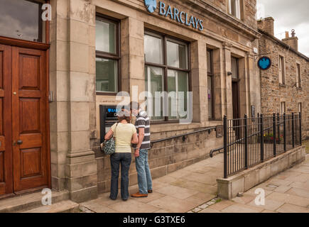 A branch of Barclays Bank set in the rural village of Middleton in Teesdale,England,UK with man and woman at cash - Stock Photo