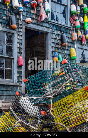 Colorful buoys adorn a rustic coastal shack, Bernard, Mt Desert Island, Maine, USA - Stock Photo