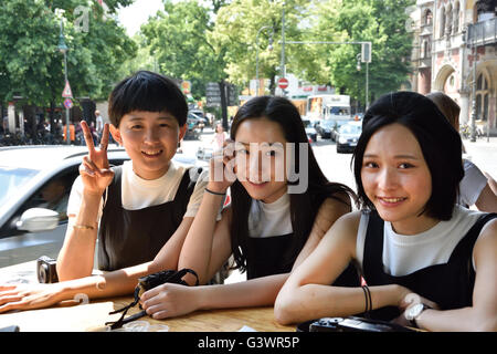 Japanese Chinese Asian young women Kreuzberg in the famous fast food Hamburger Burgermeister (  surrounding district - Stock Photo