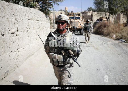 U.S. Army soldiers on a foot patrol in Afghanistan. - Stock Photo
