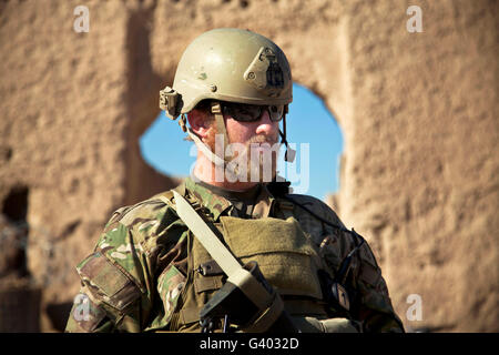 A coalition force member maintains security in an Afghan village. - Stock Photo