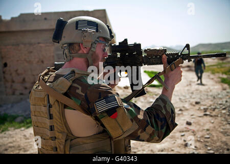 A coalition force member maintains security in Afghanistan. - Stock Photo