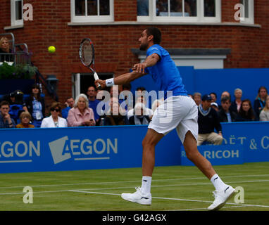Queens Club, London, UK. 18th June, 2016. Aegon Queens Tennis Championships Day Six. Marin Cilic (CRO) volleys in - Stock Photo