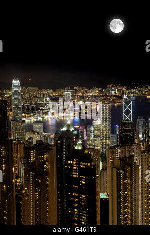 Full moon overlooking Victoria Harbor as viewed atop Victoria Peak in Hong Kong. Vertical Orientation with copy - Stock Photo