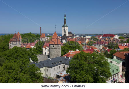The traditional red tiled rooftops and architecture of Lower Town, Tallinn, Estonia, looking towards the harbour. - Stock Photo