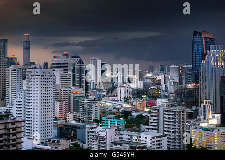 The Skyline of Bangkok with heavy monsoon clouds - Stock Photo