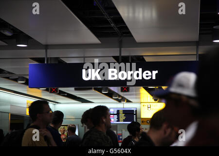UK border controls at Heathrow Terminal 3 - Stock Photo