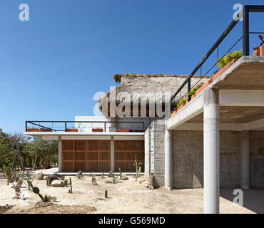 Overall exterior view from side. Casa Cal, Puerto Escondido, Mexico. Architect: BAAQ, 2015. - Stock Photo